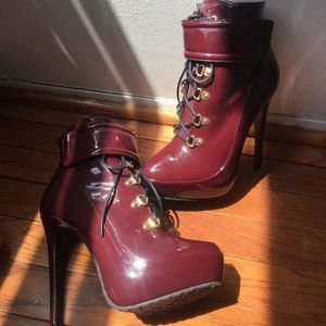 Cool and shiny burgundy heeled boots. -